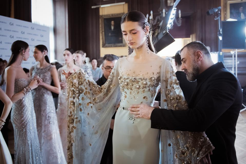 Designer Georges Hobeika is pictured while he is working on the last details Backstage prior the Georges Hobeika Spring Summer 2017 show as part of Paris Fashion Week on January 23, 2017 in Paris, France. (Photo by Francois Durand/Getty Images)