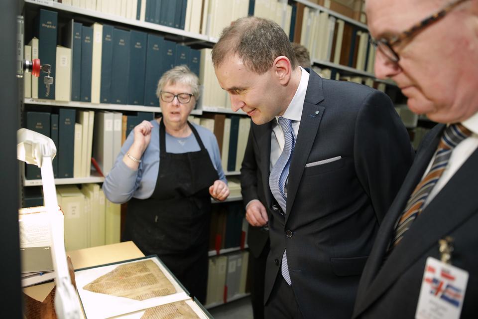 Iceland's President Gudni Johannesson (center) visits the Arnamagnaean Manuscript items at the University of Copenhagen in Denmark