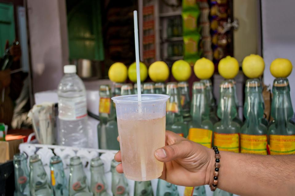 Cropped Image Of Man With Traditional Lemonade At Market Stall
