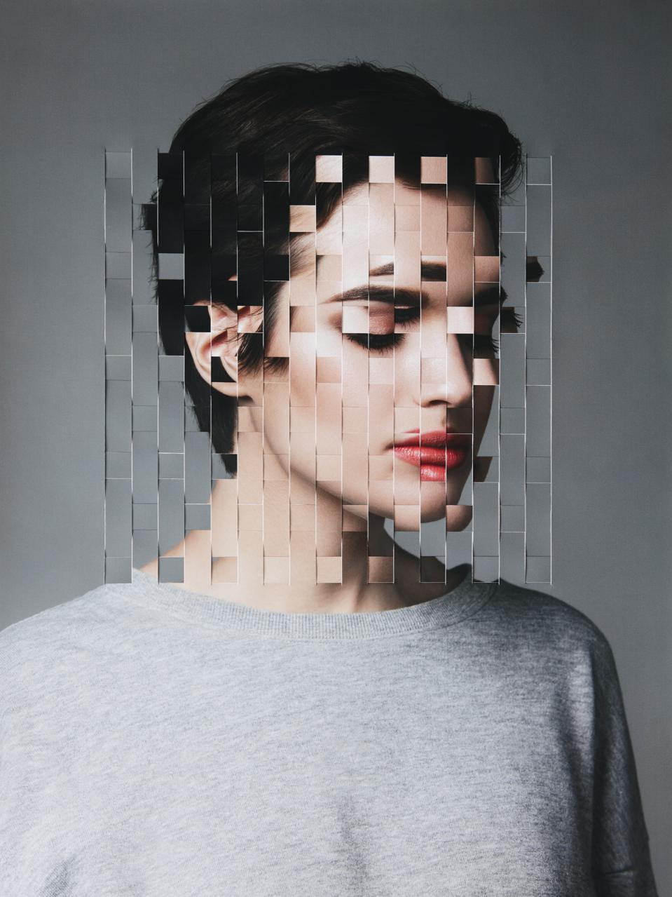 Female portrait with collaged face parts