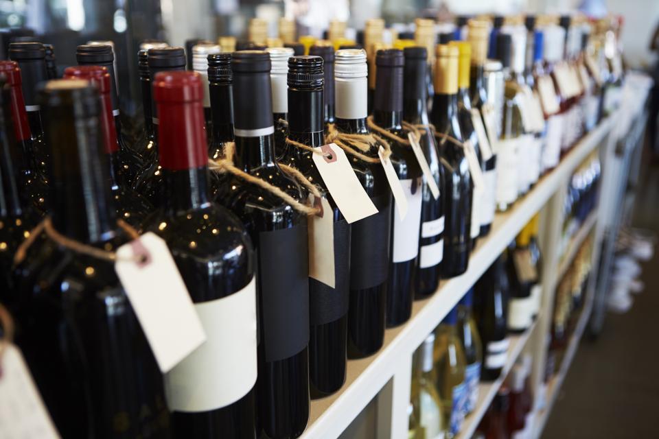 Bottles Of Wine On Display In Wine Shop