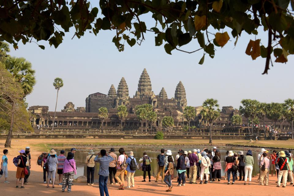 Tourists visit Angkor Wat temple in Siem Reap on February 17, 2017. Photo: TANG CHHIN SOTHY/AFP/Getty Images