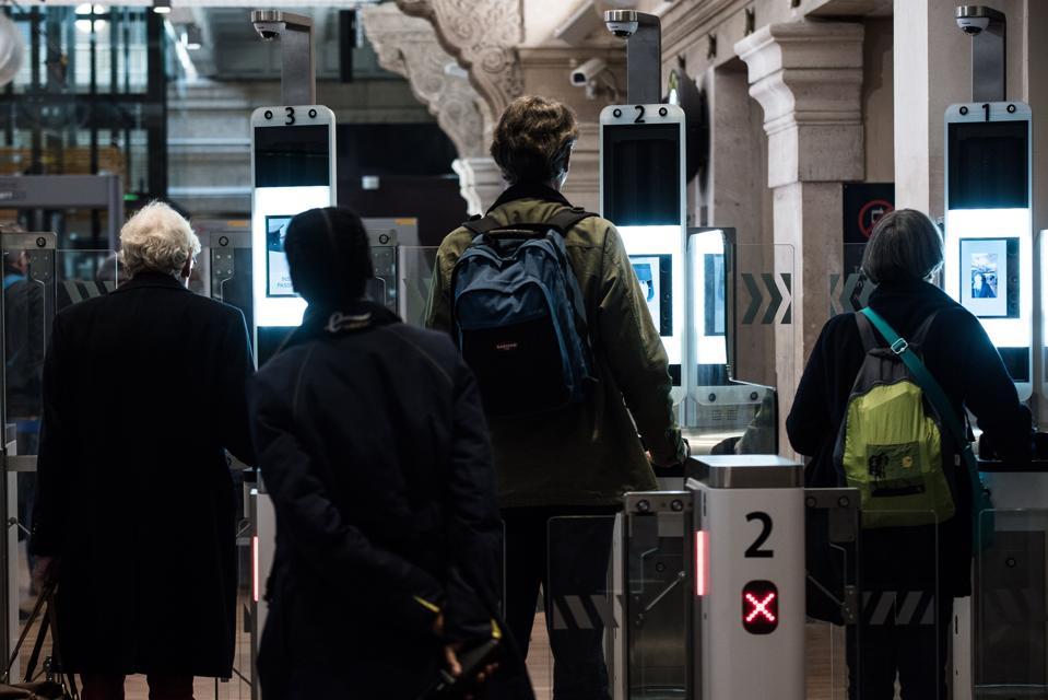 Passengers use their biometric passport at an automated ePassport gate