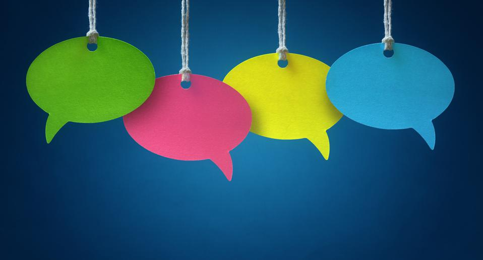 Blank, colorful speech bubbles hanging from string