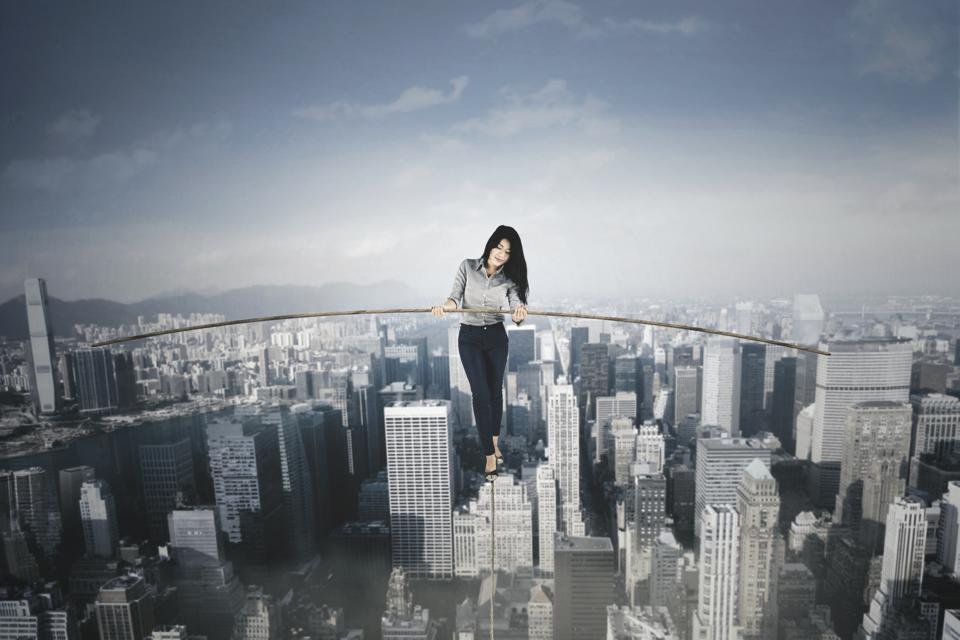 Businesswoman with a stick over a big city