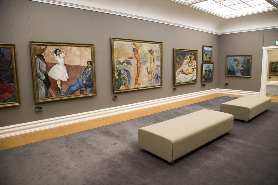 Gallery interior inside with framed paintings mounted on wall, Kode 3 art gallery, Bergen, Norway