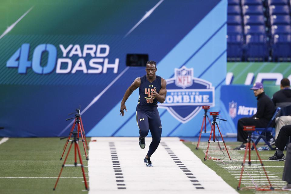 John Ross breaking the 40-yard dash record at the NFL Combine.