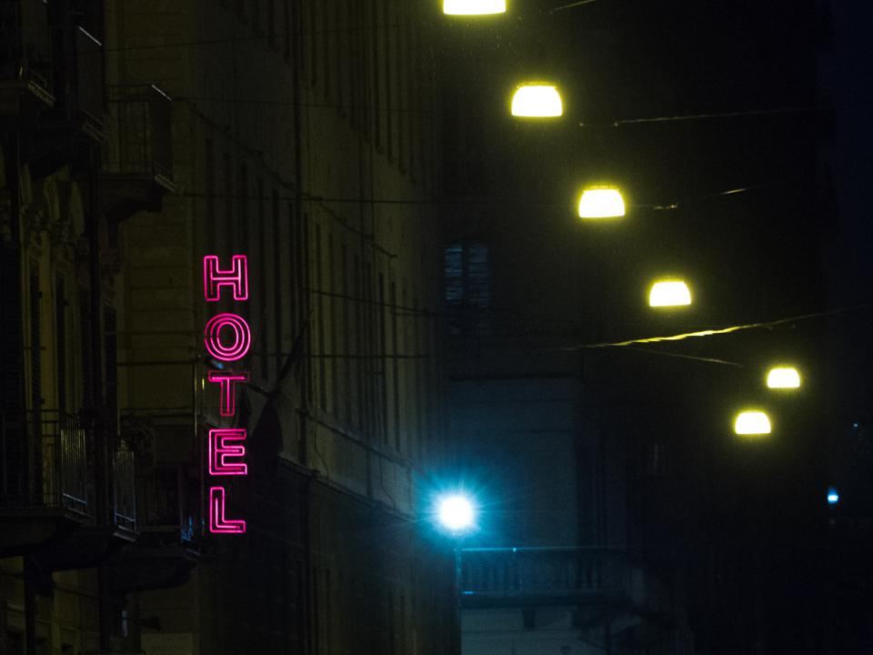 Neon Sign For Hotel Illuminated At Night