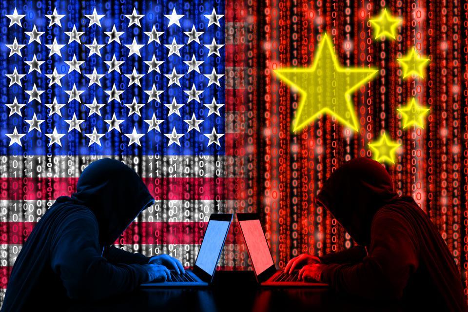 Amrican hacker sitting opposite of a chinese hacker cyberwar