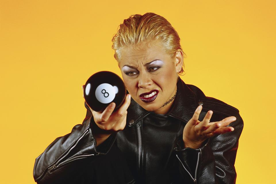 Young Woman Looking at Eight Ball