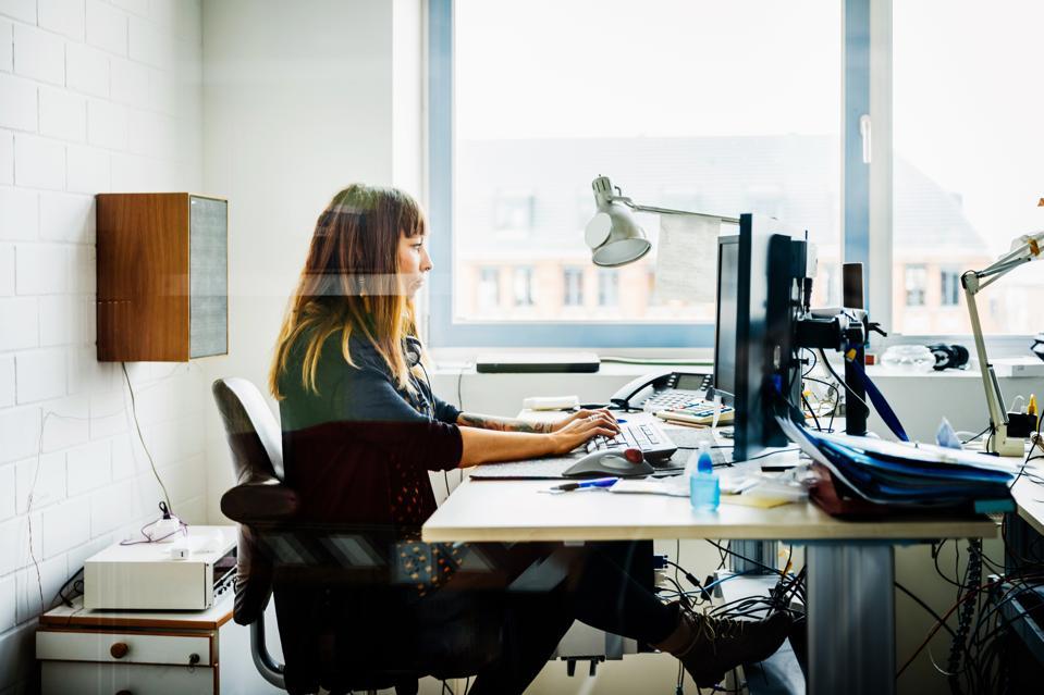 Casual businesswoman working behind her desk