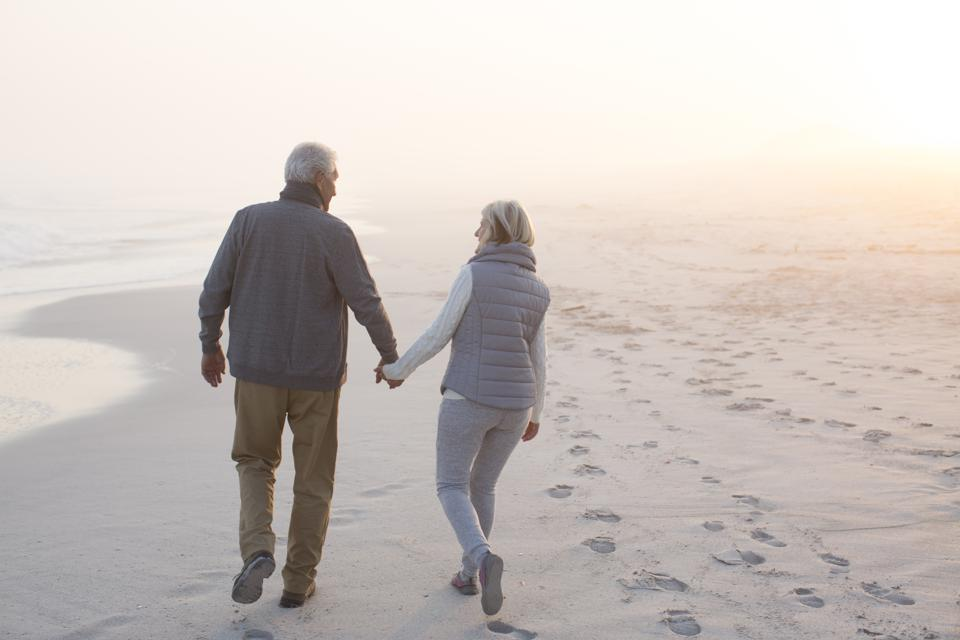 Senior couple walking on a beach together