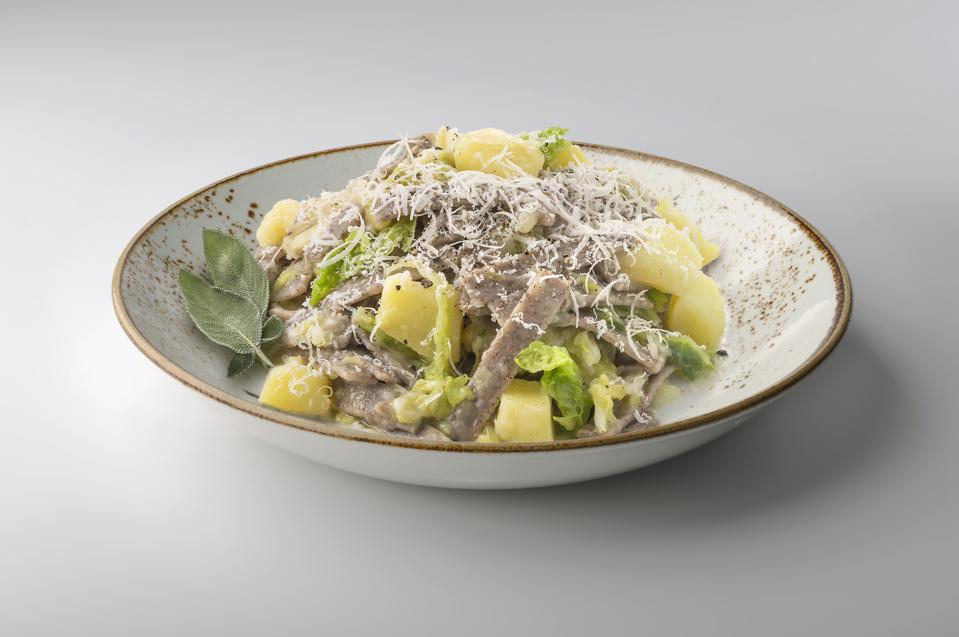 Bowl with portion of pizzoccheri