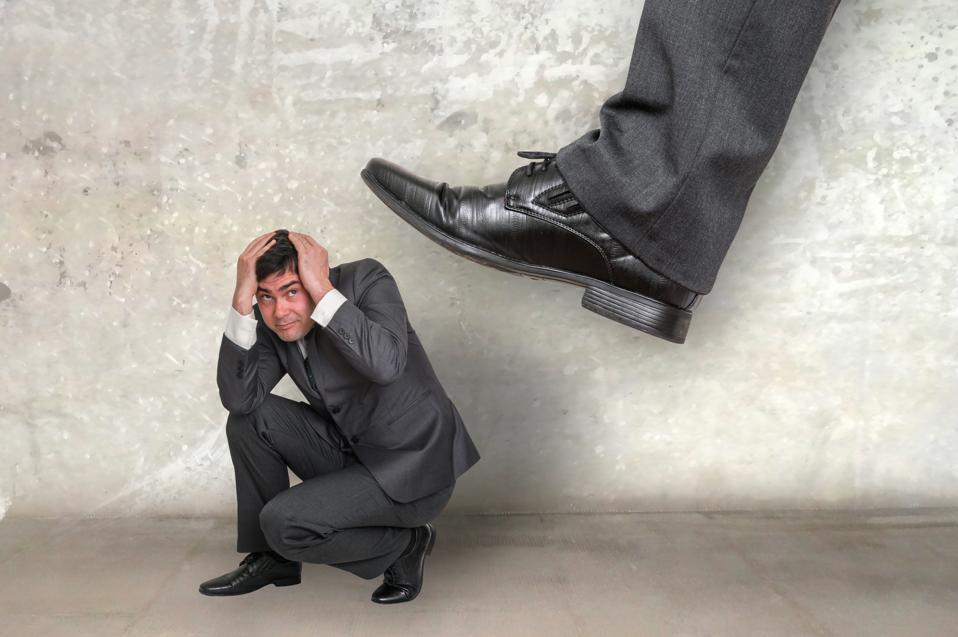 Small businessman under boss pressure