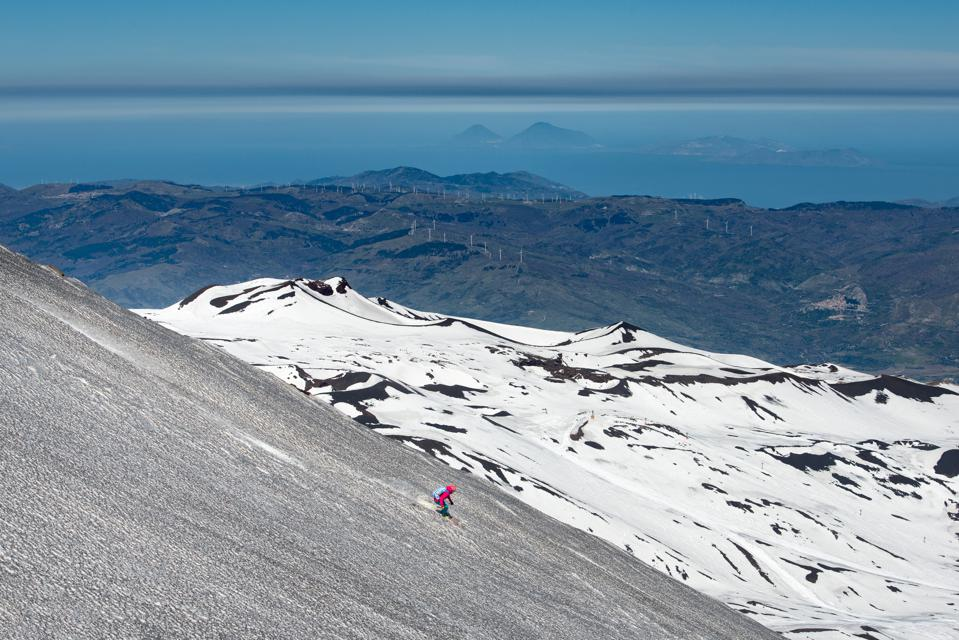 Skiing on the Etna volcano with the background of Lipari Stromboli Aeolian Islands