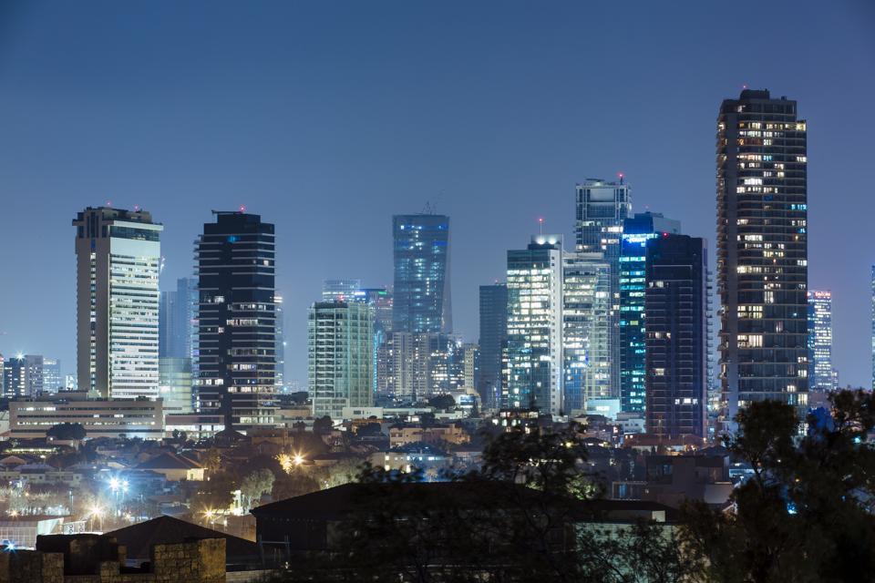 Modern illuminated skyscrapers at night in Tel Aviv downtown, Israel