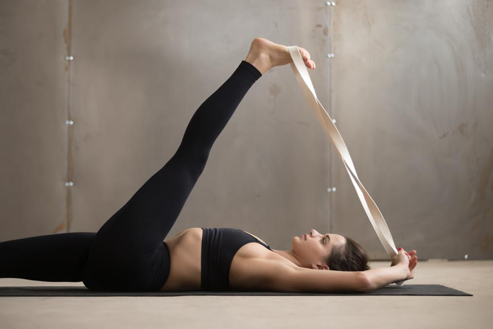 Have a blanket ready to support your knees during your at-home yoga class.