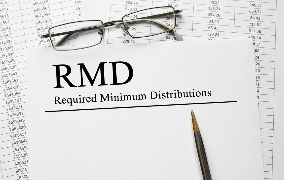 Paper with Required Minimum Distributions RMD on a table