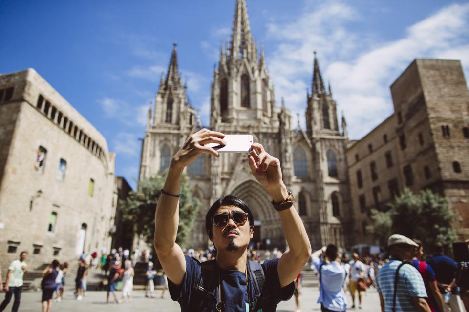 Asian man taking selfie