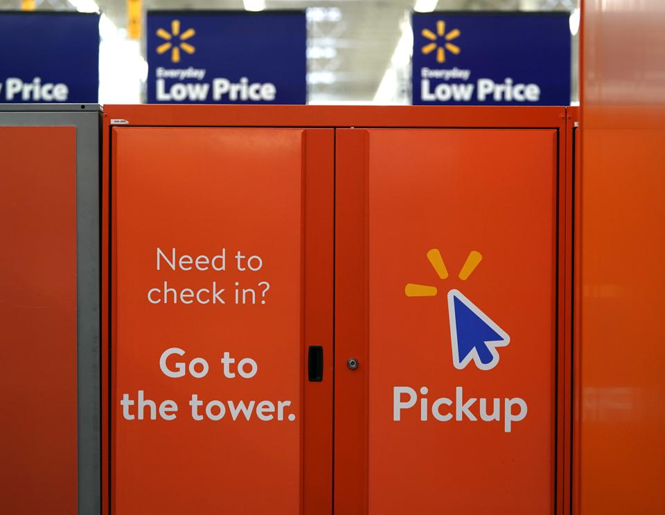 Signs directing customers to pickup orders placed online are shown at a Walmart Supercenter  in Houston.