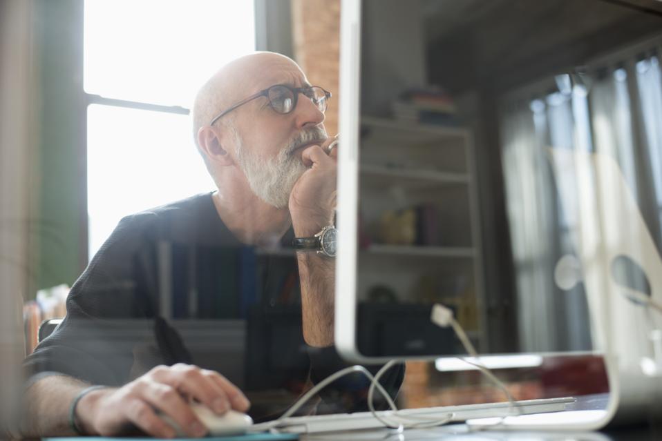 Hispanic businessman using computer