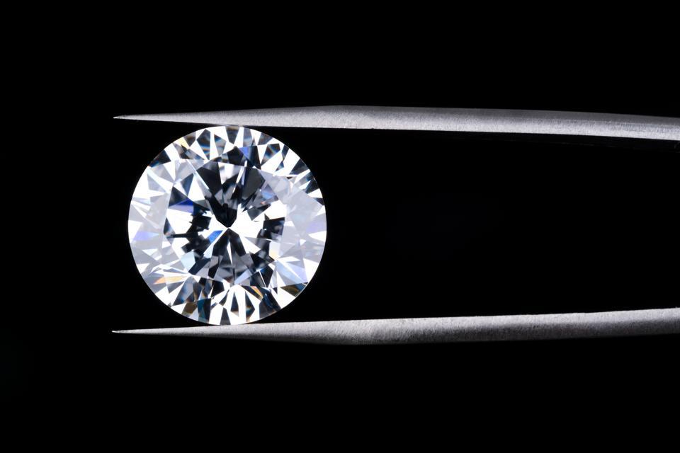 Round Diamond Clamped by Tweezers