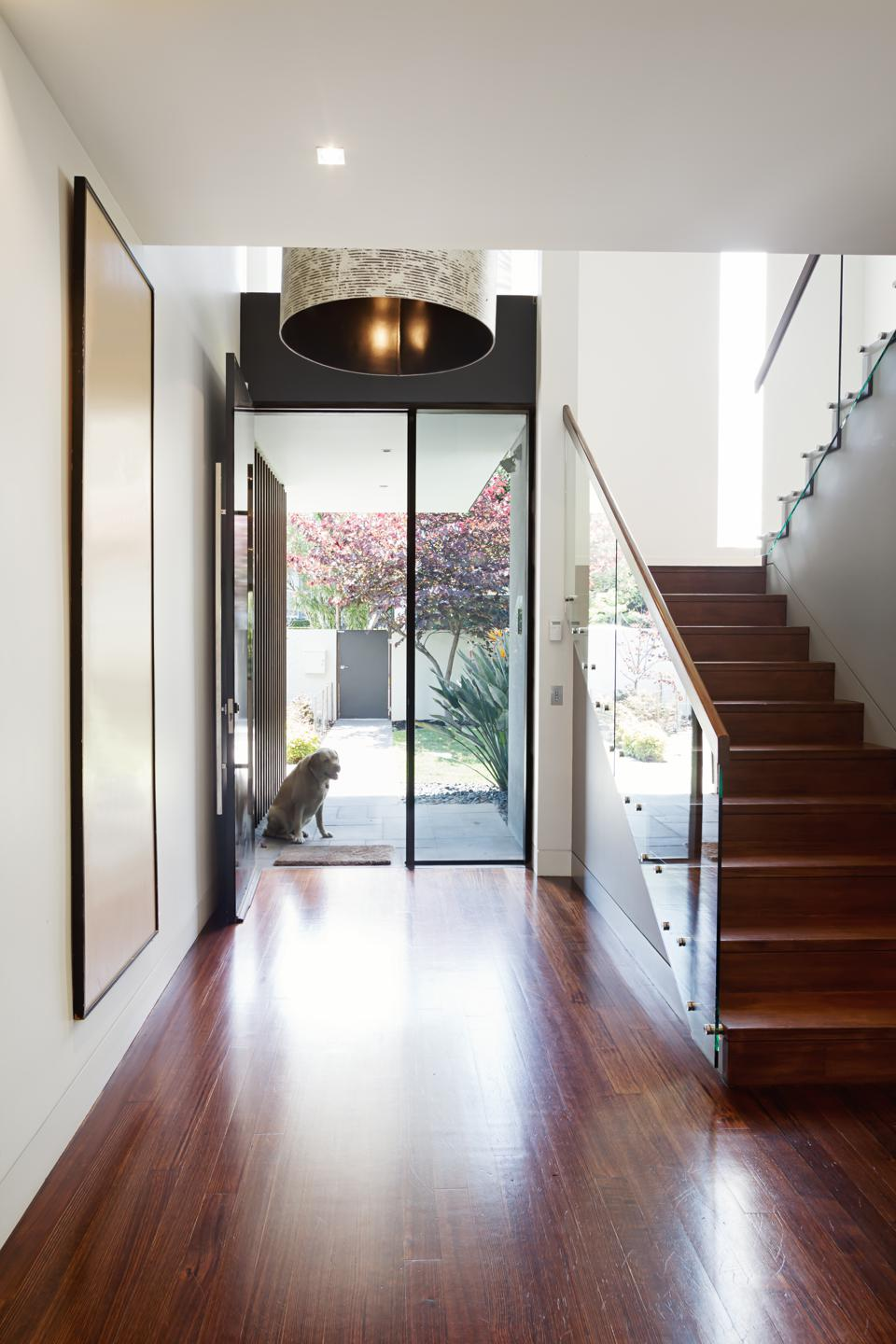 Entry foyer of architect designed modern Australian home with wooden floor