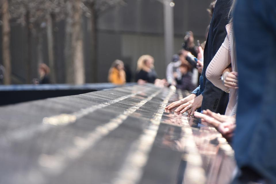 National September 11 Memorial in Manhattan, People touch the names of loved ones