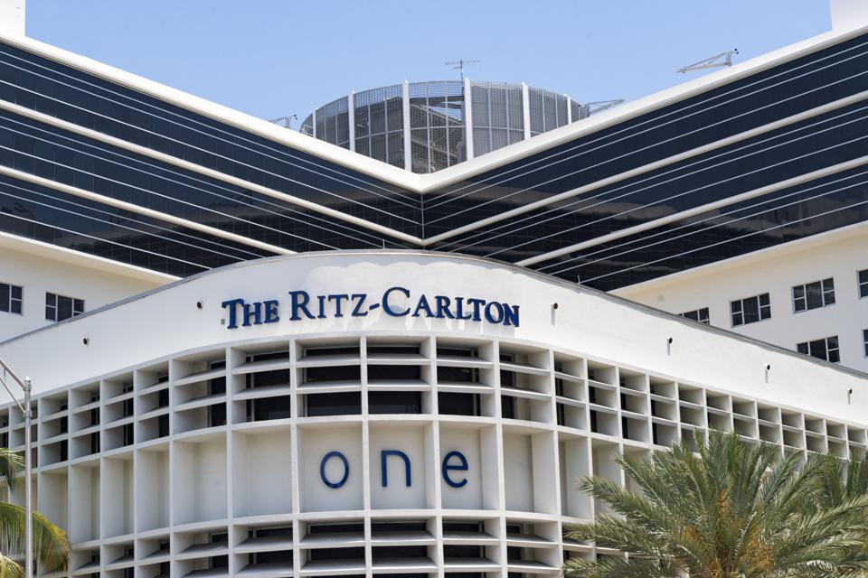 The Ritz-Carlton hotel building facade exterior with logo or...