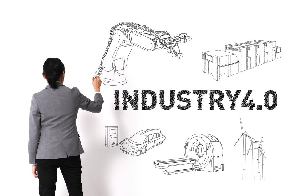 asian woman drawing illustrations of Industry4.0 on white wall