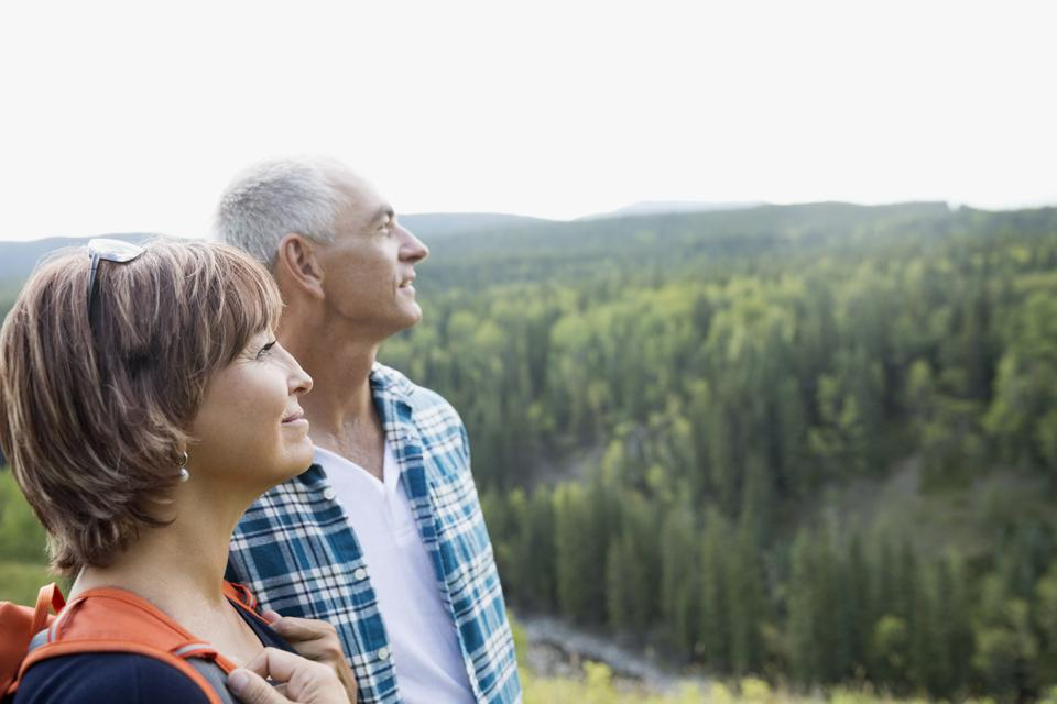 Mature couple hiking looking at remote rural view
