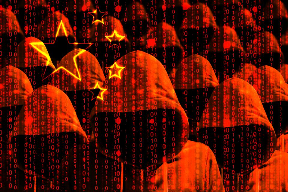 Group of hooded hackers shining through a digital chinese flag