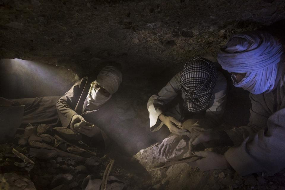 Tomb robbers illegally digging for treasures