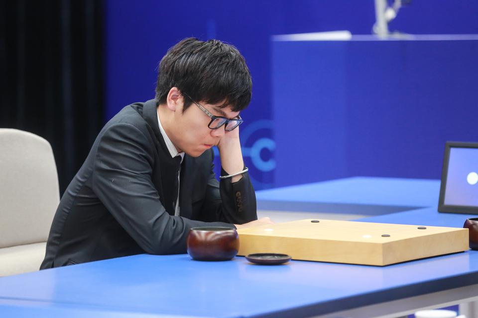 A Go master studying a board