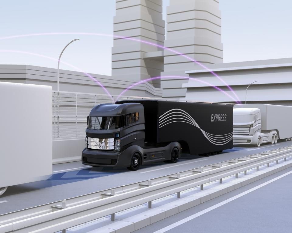 A fleet of autonomous truck driving on highway