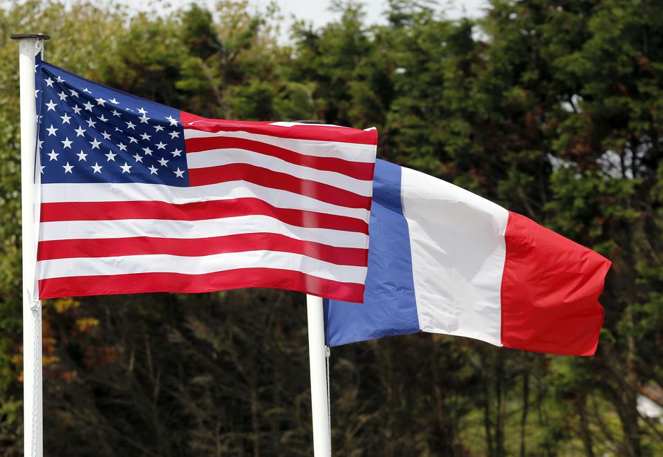 An American and a French flag during commemorations marking D-Day