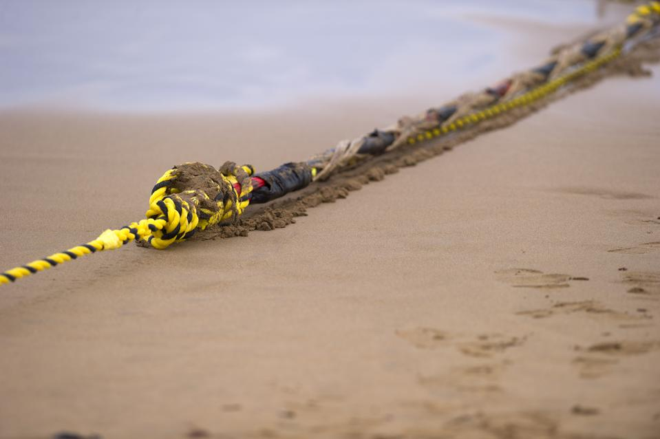 An undersea fiber optic cable is attached to a rope at Arrietara beach near the Spanish Basque village of Sopelana on June 13, 2017.
