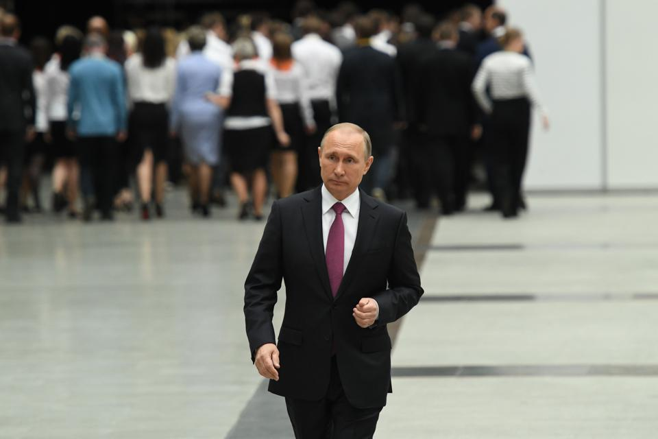 Russian President Vladimir Putin walks after his annual 'Direct Line with Vladimir Putin broadcast live' by Russian TV channels and radio stations at the Gostiny Dvor studio in Moscow on June 15, 2017.