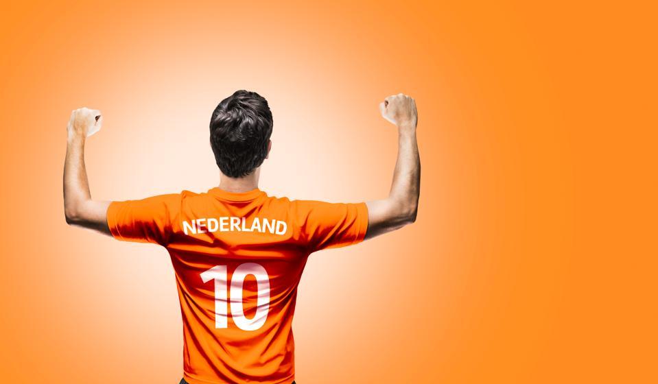 Dutch Fan / Sport Player on uniform celebrating