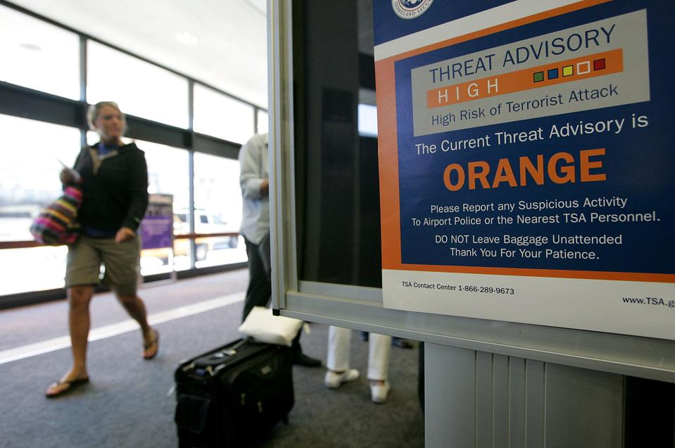 Throughout airports in the decade after 9/11, passengers got used to gauging the risk of terrorism by the color displayed. Why not use a similar system for pandemics?
