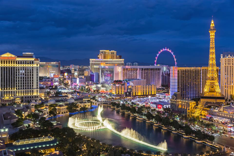 USA, Nevada, Las Vegas, Strip, fountain, hotels and Eiffel Tower at blue hour