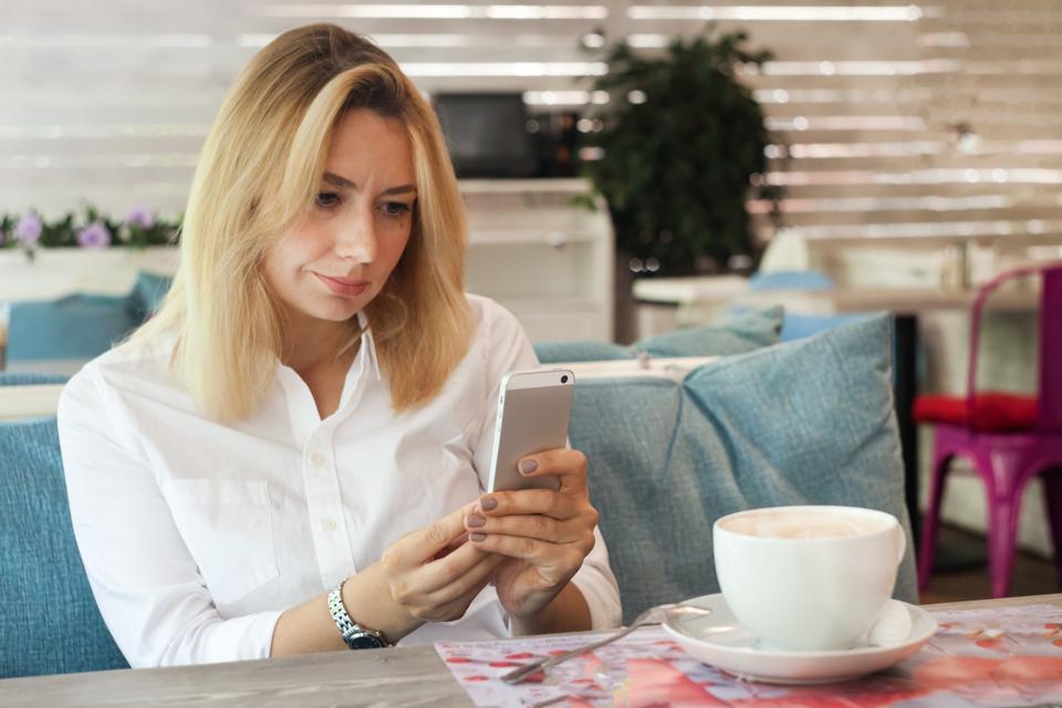 Woman on social media sending out a tweet