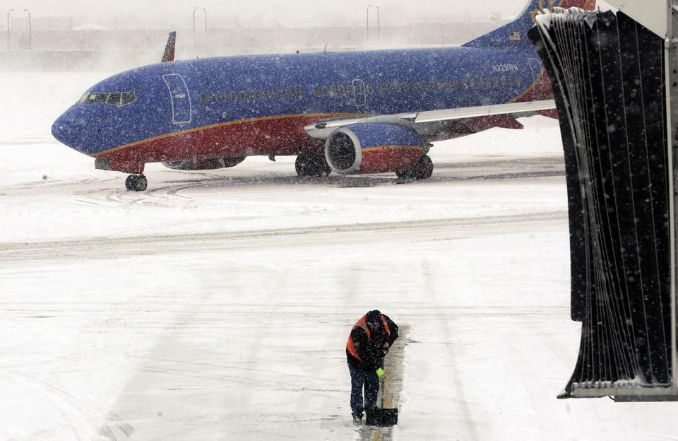 Workers clear a path for a delayed South...