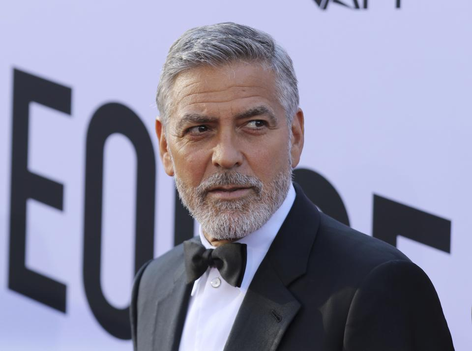 ″We have never heard of this summit and have never been approached to be part of a charity that is charging 399.00 for people to participate,″ George Clooney said in a statement to Forbes.
