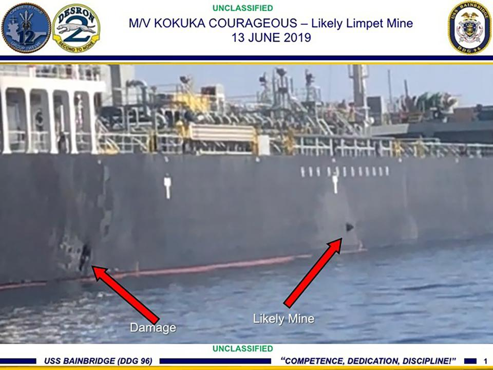 Damage and a suspected mine on the Kokuka Courageous.