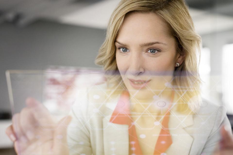 Businesswoman using futuristic portable device