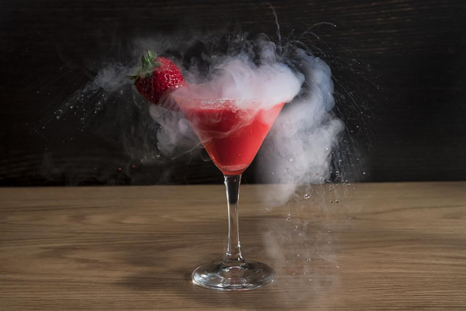 Strawberry martini Cocktail with liquid nitrogen