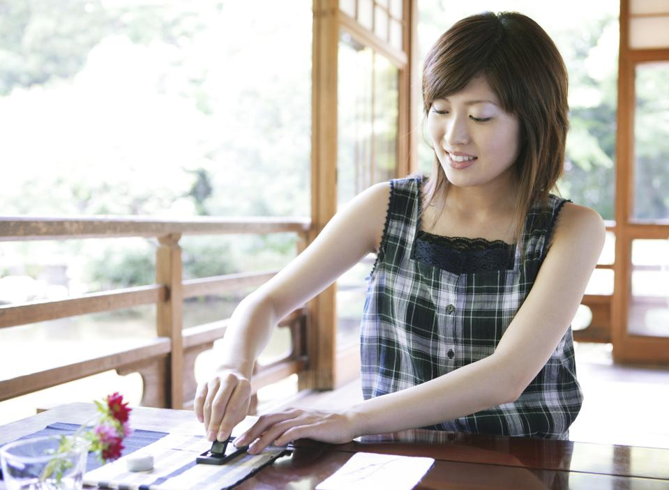 Japanese woman writing summer letter