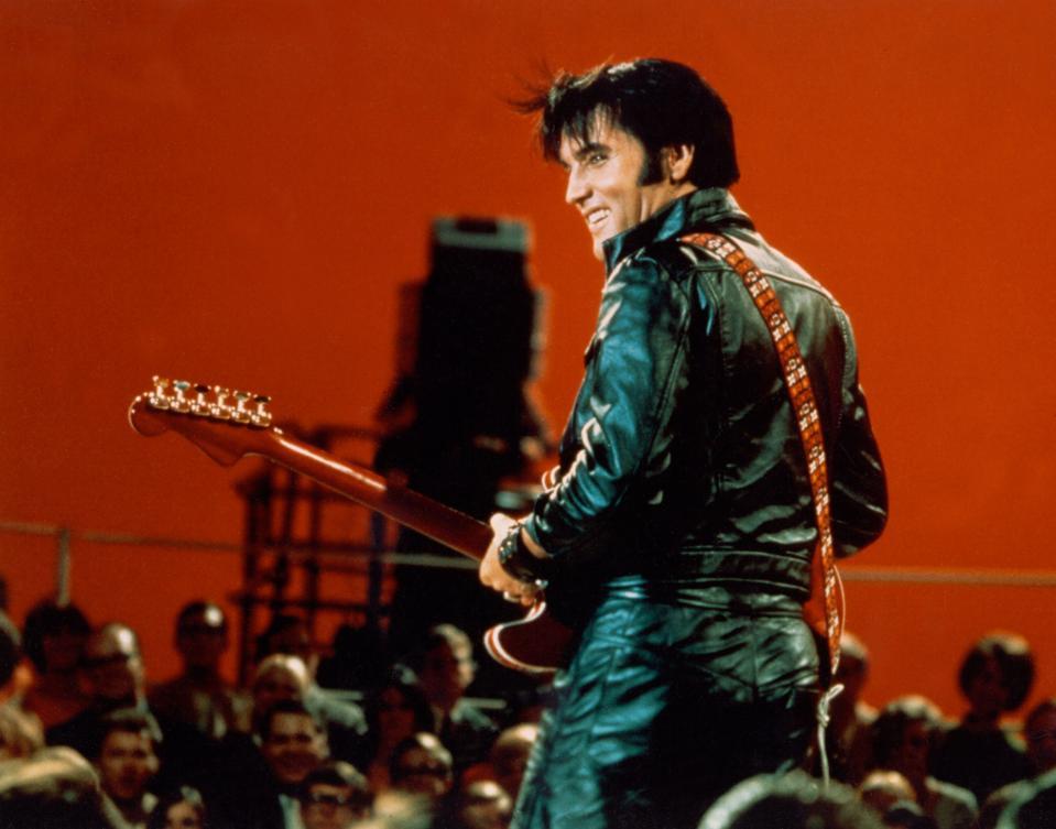 Rock and roll musician Elvis Presley performing ...