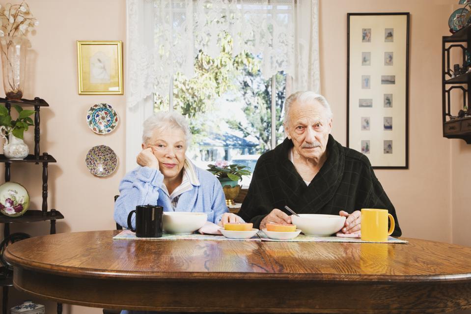 Senior couple at breakfast table
